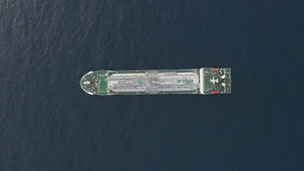 straight top view oil tanker with green deck sails in ocean