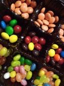 Fotografia Foto a macroistruzione variopinte del confetto al cioccolato dolce jelly bean cibo gustoso dessert