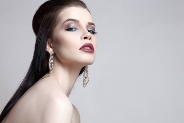 fashion portrait of beautiful young woman in jewelry.Beauty girl with short hair and make-up.elegant lady