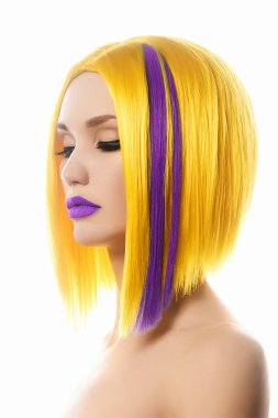 Yellow purple Hair. Haircut. Beautiful Girl with Color Hair. Hairstyle. Bob. Fringe. Profile Portrait of Fashion Beauty Woman