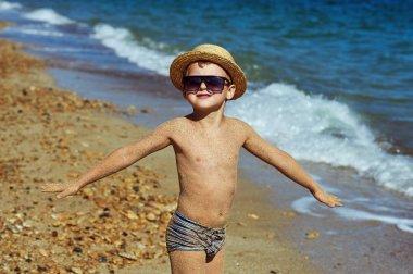 Cheerful boy resting on the sea
