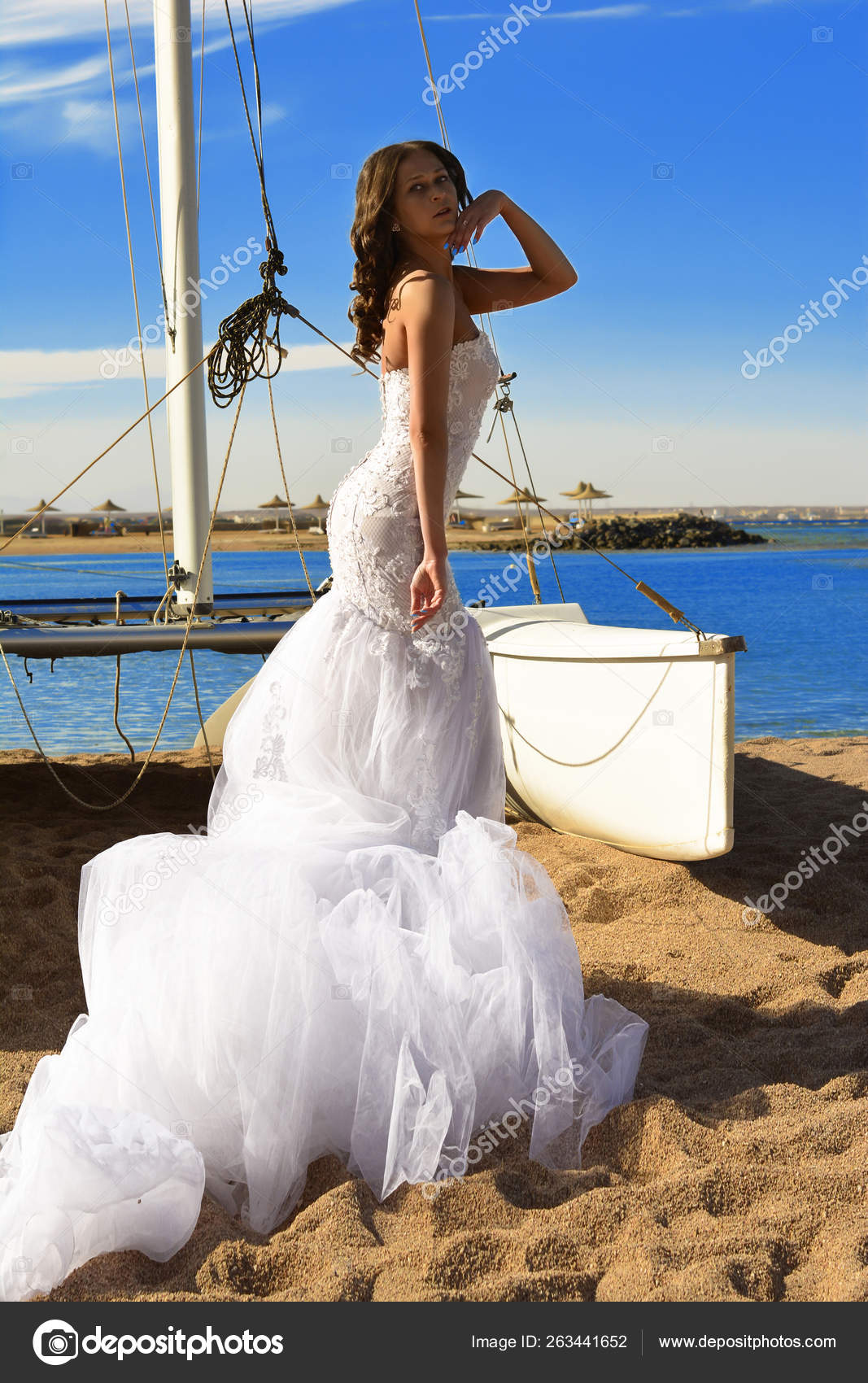 Stunning sexy young bride in amazing dress