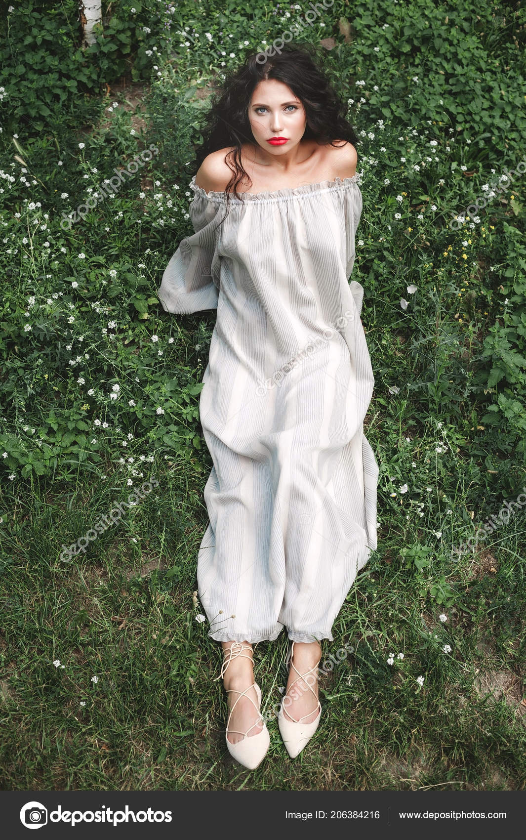 Curly Girl In A Sundress Lies On The Grass With White Flowers Photo By Steineranden