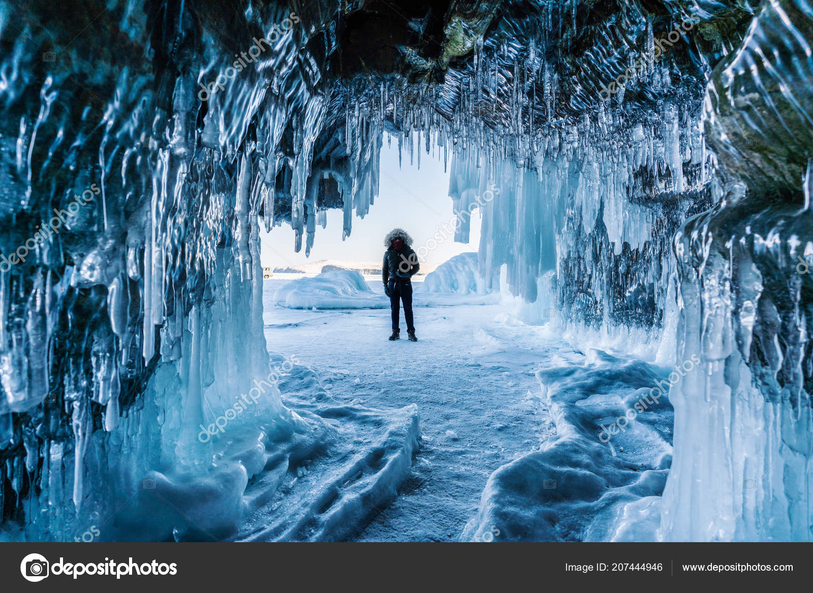 travelling winter man standing frozen lake baikal ice cave irkutsk