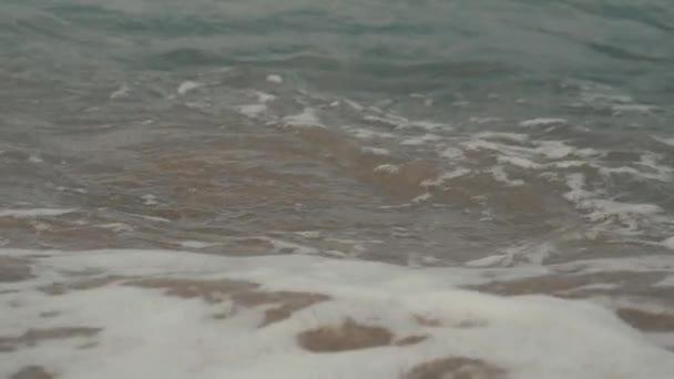 Silky waves on the sea pebbles. Shingle beach