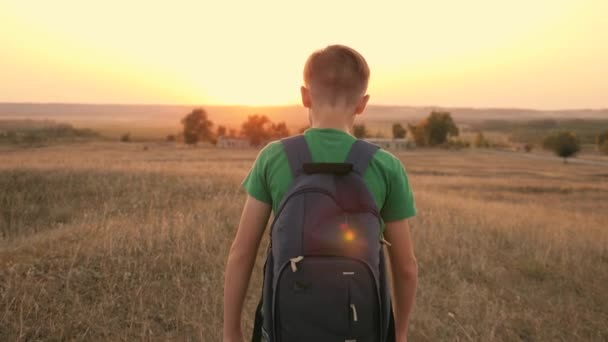 Boy with a backpack is on the field. Hike. Tourism and tourist travel