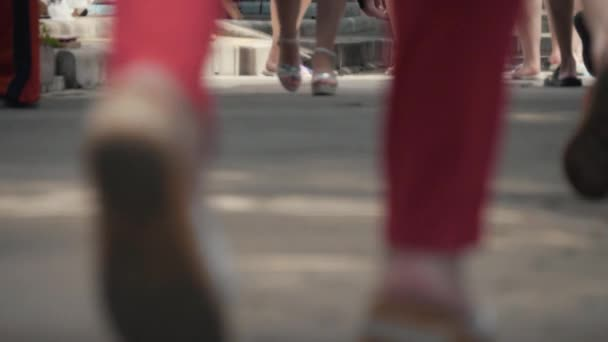 Close-up of foot walking people on the sidewalk. People hurrying about their business