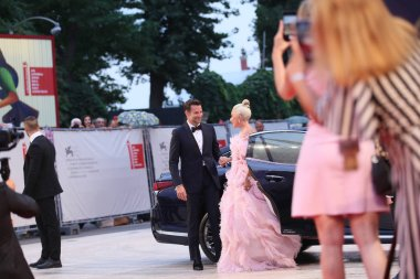 Bradley Cooper and Lady Gaga walk the red carpet ahead of the 'A Star Is Born' screening during the 75th Venice Film Festival at Sala Grande on August 31, 2018 in Venice, Italy.