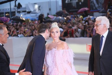 Lady Gaga, Alberto Barbera, Paolo Baratta,  Bradley Cooper walk the red carpet ahead of the 'A Star Is Born' screening during the 75th Venice Festival at Sala Grande on August 31, 2018 in Venice, Italy.
