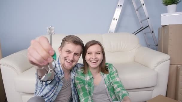 Young couple holding new flat keys