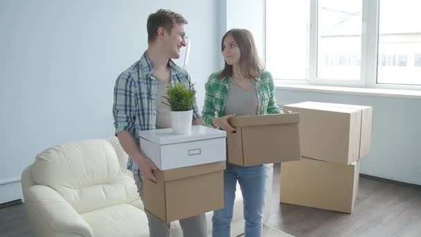 Smiling Young couple moves to a new apartment