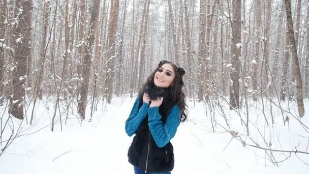 Happy Young woman at winter forest or park