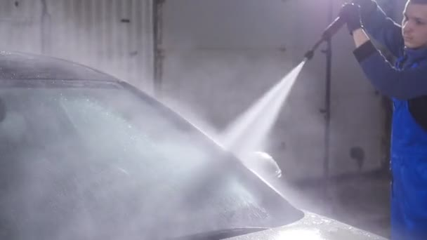 Man washes car with high pressure water