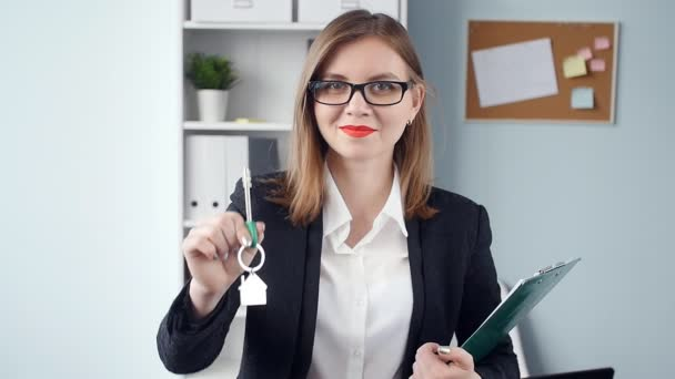 Woman realtor is giving the keys to an apartment to clients