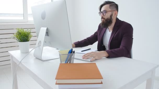 Concept of freelancing and office work. Young Male office worker in the workplace