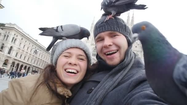 Happy Couple taking self portrait with pigeon. Traveling and relationship concept