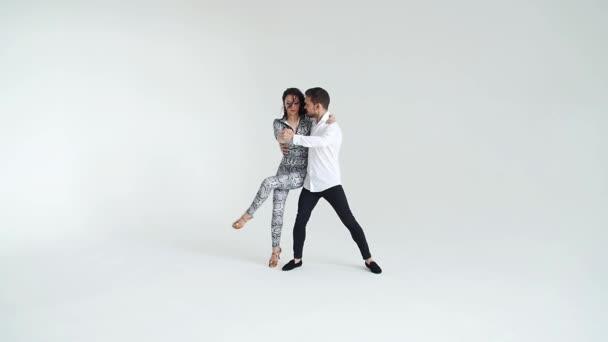 Concept of love, relationships and social dancing. Social dance, salsa, zouk, tango, kizomba concept - beautiful couple dancing bachata