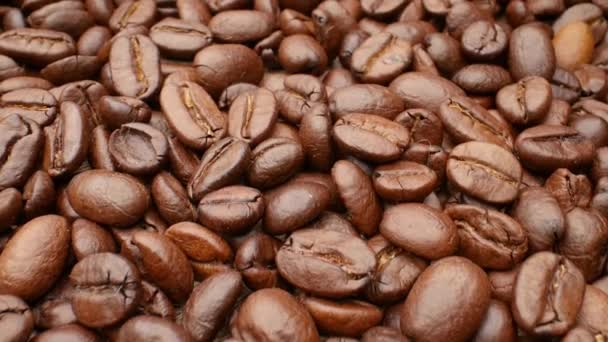 Close-up, smooth moving roasted coffee beans