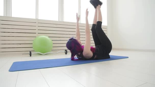 Sport and healthy lifestyle concept. Young woman doing physical exercises at home or in the gym