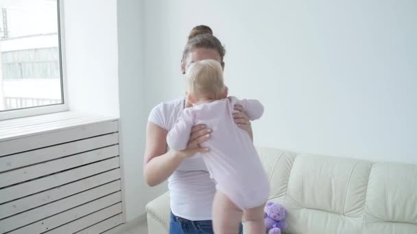 Children and parents concept - Mother and her little baby at home