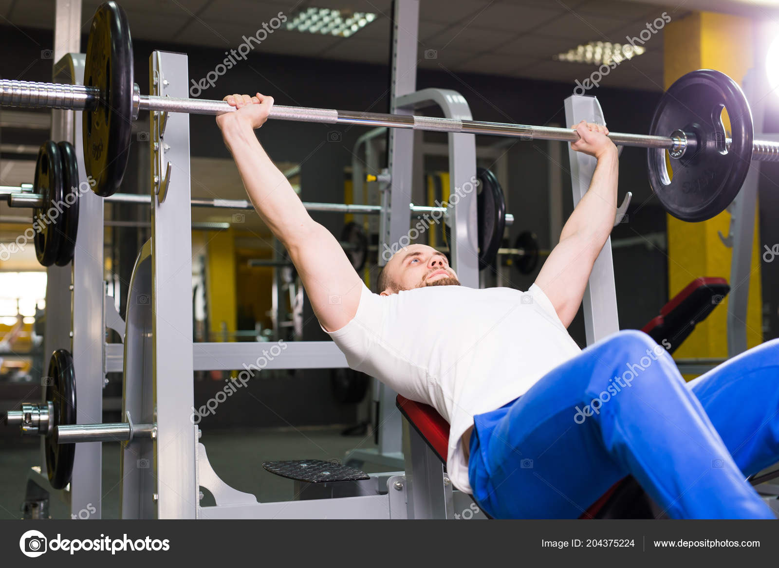 Sport Fitness Training And People Concept Man During Bench Press