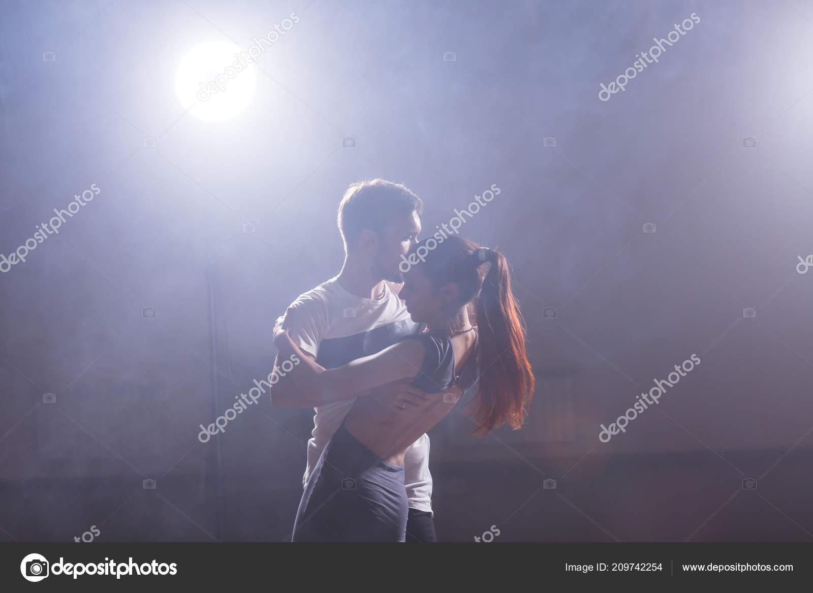 Young couple dancing latin dance Bachata, merengue, salsa  Two