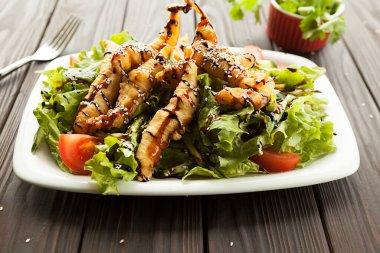 shrimp vegetable salad in batter on a dark wooden table, oriental and asian cuisine