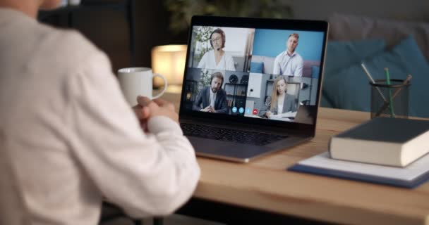 Woman having online meeting with coworkers on laptop