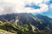 Fotografie Scenic view of high tatras mountains under blue cloudy sky in Slovakia