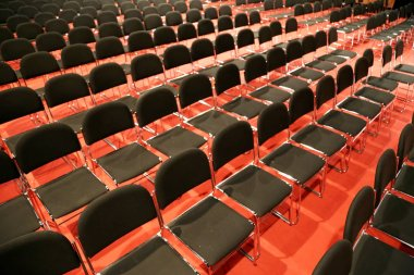 Rows of empty seats of an empty conference hall