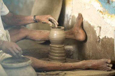 modeling of clay on a potter's wheel In the pottery workshop
