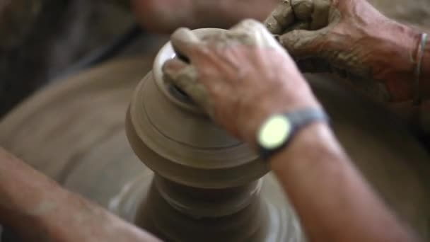 modeling of clay on a potters wheel In the pottery workshop