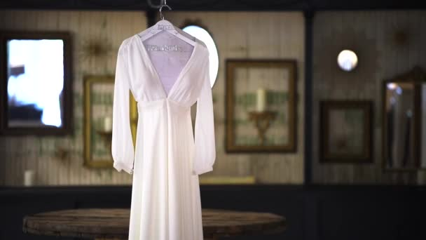wedding, bride dress hanging on a hanger and spinning