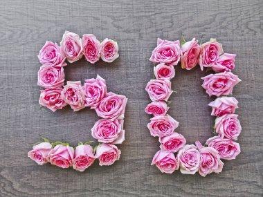 Vintage number of pink roses on the background of dark wood - for congratulations, postcards, websites, design, printing