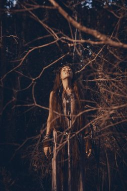 Beautiful young woman model with very long hair. witch craft concept
