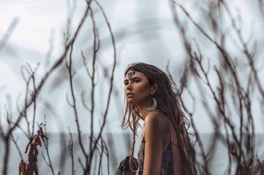 beautiful young boho style woman outdoors