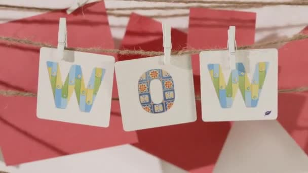 WOW word collected by child hand from paper cards