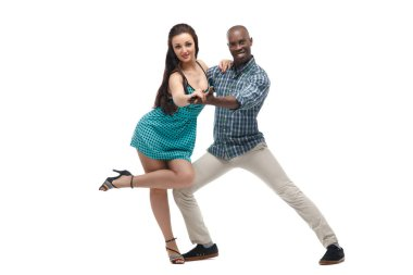 Black man and caucasian woman in casual clothes in incendiary dance isolated on white background.