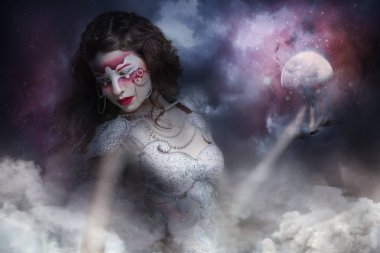 mysterious warrior witch with moon in hand in storm