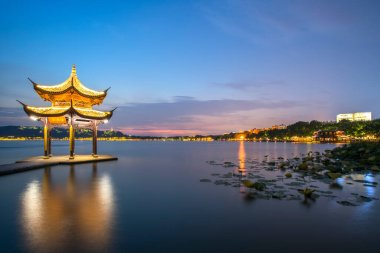 Night scenery of ancient architectural landscape in West Lake, H