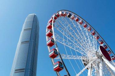 Ferris wheel and skyline of urban architecture in Hong Kon