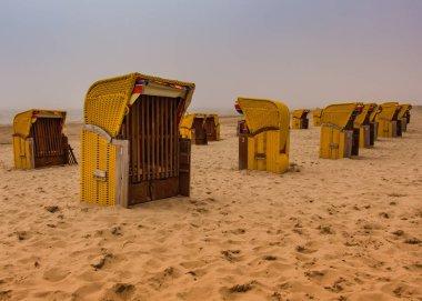 Dutch beach chairs-cabins, tourist accommodation at North Sea coast line, Egmond aan Zee, Netherlands. Popular tourist destination near Amsterdam.