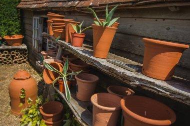 NORTHIAM, GREAT BRITAIN - JULY 13 , 2017- ceramic flower pots on