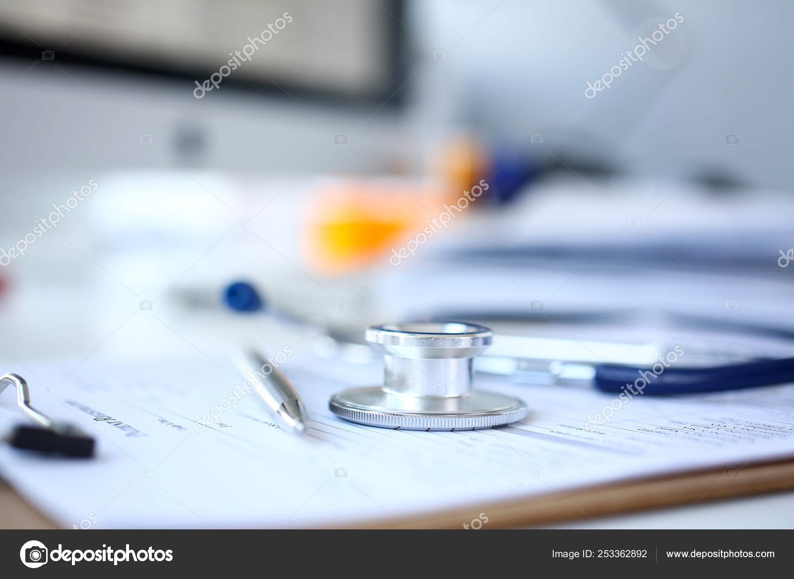 Stethoscope head and silver pen lying on medical application ... on medical assistant job application, office assistant job application, restaurant job application, medical center job application,