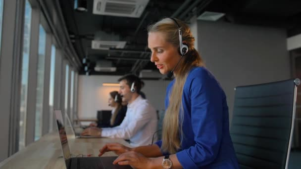 Young businesswoman talk on headset
