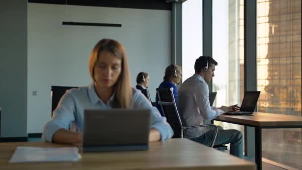 Boss female controls call-center agency in business office