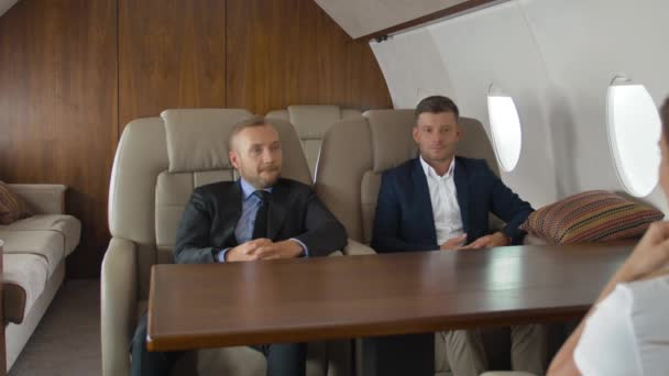 Premium view of businesspeople have meeting in corporate jet