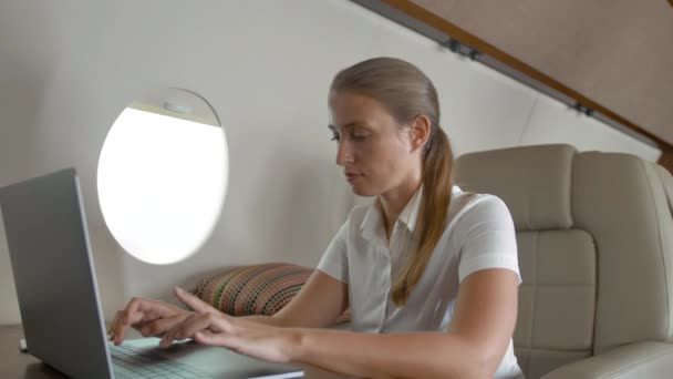 Air hostes ask confident businesswoman about service inside private jet cabin aircraft