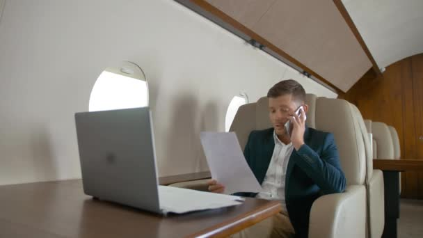 mature business man talking by mobile phone partner connection aircraft jet travel