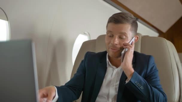 Happy mature businessman talk by phone partner connection aircraft jet travel